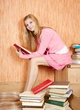 Girl with books on sofa Royalty Free Stock Image