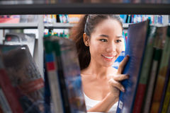 Girl among books Stock Photos