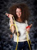 Girl with booster cable. Theatrical image of woman with booster cable Royalty Free Stock Photography