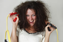 Girl with booster cable. Theatrical image of woman with booster cable Royalty Free Stock Image