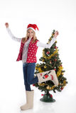 Girl in boots in Christmas tree Stock Image