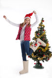 Girl in boots in Christmas tree Royalty Free Stock Photos