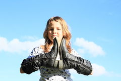 Girl with boots on hands Stock Images
