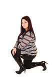 Girl in boots kneeling. Stock Images