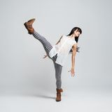 Girl in boots takes a big step Stock Images
