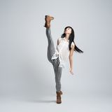 Girl in boots takes a big step Royalty Free Stock Image