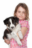 Girl and border collie puppy. In front of white background royalty free stock images