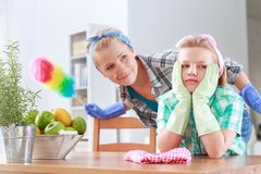 Girl bored during cleaning Royalty Free Stock Photo