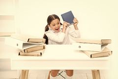 Girl bored pupil sit at desk with folders and books. Issues of formal education. Back to school concept. Kid cute tired royalty free stock image