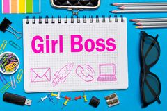 Girl Boss notes in a notebook on the Desk in the office. Business girl concept.  royalty free stock photo