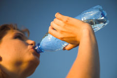 Girl with bottle stock images