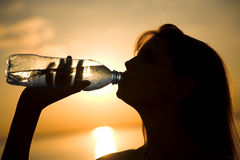 Girl with bottle Royalty Free Stock Images