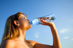Girl with bottle Royalty Free Stock Photography
