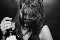 Girl with bottle of alcohol Stock Image