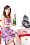 Girl with a bottle of champagne Stock Image