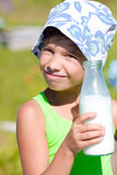 Girl with bottle of milk in summer Royalty Free Stock Images