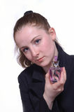 The girl with a bottle of perfume in the hand. The girl with  a bottle of perfume in the hand Royalty Free Stock Photo