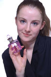 The girl with a bottle of perfume in the hand. The girl with  a bottle of perfume in the hand Stock Photo