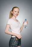 Girl with bottle of water Royalty Free Stock Photos