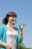 Girl with bottle of water Stock Images