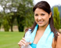 Girl with a bottle of water Stock Photography