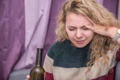 Girl with a bottle of wine in hand stock photo