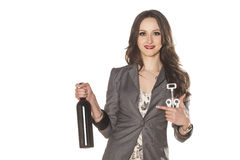 Girl and a bottle of wine Royalty Free Stock Photos