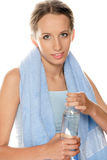 Girl with bottled water Stock Images