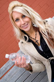 Girl with Bottled Water Royalty Free Stock Photography