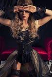 Girl in boudoir Stock Images
