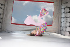 Girl in bounce house. A young girl jumping in a bounce house Royalty Free Stock Image