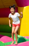 Girl on the bouncy castle Royalty Free Stock Photography