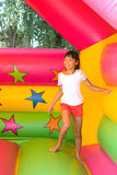 Girl on the bouncy castle Royalty Free Stock Image