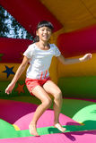 Girl on the bouncy castle Stock Photography