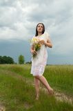 Girl with bouquet Royalty Free Stock Images