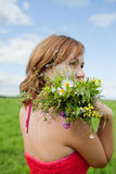 Girl with a bouquet Royalty Free Stock Image