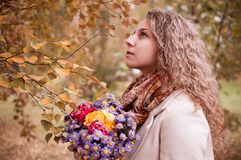 Girl with a bouquet of autumn stock photo