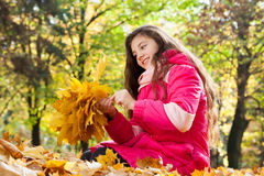 Girl with bouquet from autumn leaves Royalty Free Stock Images