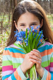 Girl with bouquet of bluebells Stock Photography