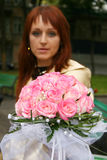 The girl with a bouquet of the bride. The young beautiful girl has control over a bouquet of the bride Stock Photography