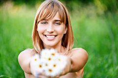 Girl with bouquet of camomiles Royalty Free Stock Images