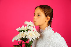 The girl with a bouquet of camomiles Royalty Free Stock Photography