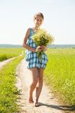 Girl with bouquet of camomiles Stock Photography