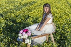 Girl with bouquet and  communion dress Stock Photo
