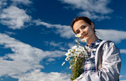 Girl with a bouquet of daisies Stock Photo