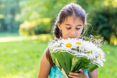 Girl with bouquet of daisies Stock Image
