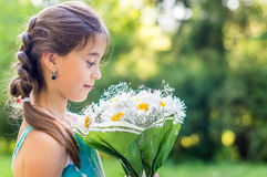 Girl with bouquet of daisies Royalty Free Stock Photo