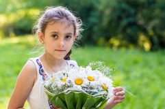 Girl with bouquet of daisies Royalty Free Stock Image