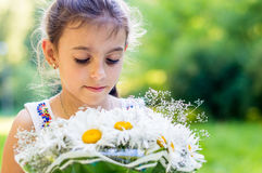Girl with bouquet of daisies Stock Photos