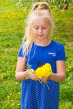 Girl with a bouquet of dandelions Stock Images